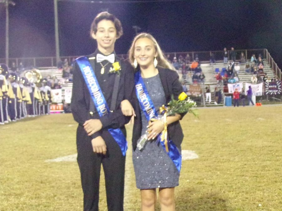 "Dominick Wright, 10, and Ashlie Stone, 10, represent the freshmen class in the homecoming court at the 2019 homecoming football game against Grassfield High School. Wright was nominated by his peers for homecoming court and won alongside his girlfriend, Stone. ""It was really cool to win Homecoming court as Freshmen and I knew that Ashile was really exciting so that just added to it,"" Wright said."