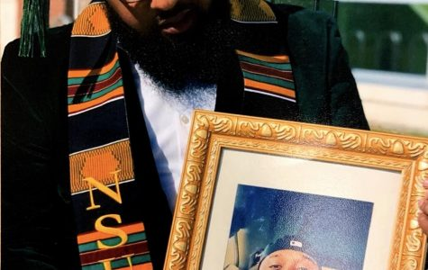 Antonio Howell holds a picture of his twin brother after graduation. His brother passed away on May 9th, 2014.