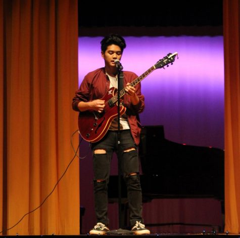 At the talent show, Adrian Alcozar, 11, sang and played the guitar. The talent show featured several different acts including singing, guitar, monologues and poetic readings.