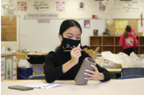 Tammy works on a project for ceramics and is looking forward to the final product.